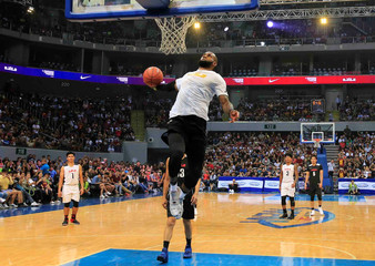 National Basketball Association star player Lebron James of Cleveland Cavaliers dunks during an exhibition game with members of the Philippine Basketball Association team, in Manila