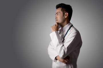 Professional Male doctor or scientist in white coat looking on virtual screen isolated on black. medicine, cardiology and health-care concept