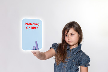 Little girl with is touching a transparent rectangle with inscription Protecting Children