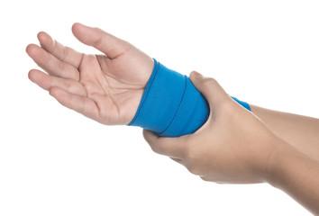 Wrist wrapped in elastic bandage on white background,wrist pain