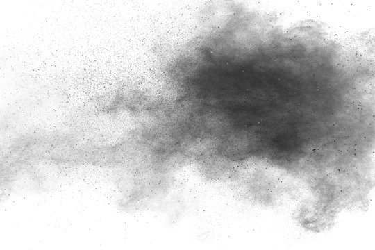 Black powder explosion against white background.