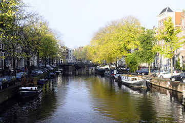 Old city houses along canal in Amsterdam, Holland