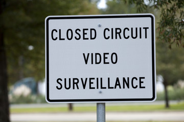 Sign warning people that close circuit video surveillance is being used.