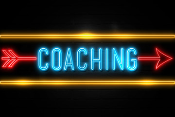 Coaching  - fluorescent Neon Sign on brickwall Front view
