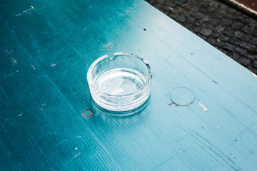 glass ashtray on a green table