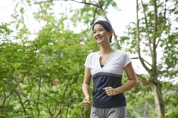 Woman running in Botanic Gardens, Singapore