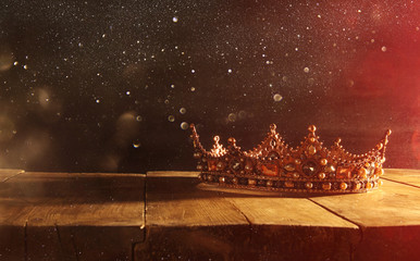 low key of beautiful queen/king crown over wooden table. vintage filtered. fantasy medieval period Fototapete