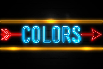 Colors  - fluorescent Neon Sign on brickwall Front view