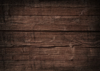 Brown wooden wall, planks, table, floor surface. Dark wood texture.