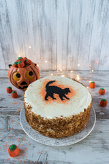 Halloween cake with black cat in rustic setting rustic setting