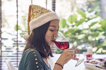 Woman sipping wine on Christmas day