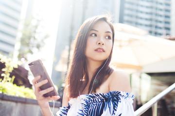 Pretty Asian Girl Walking Down The Street