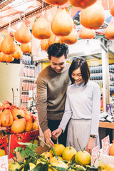 Beautiful couple buying fruits in Chinatown, Singapore
