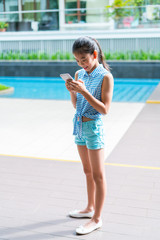 Young lady texting on her cellphone