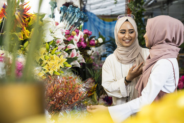 Two muslim ladies shopping for flowers