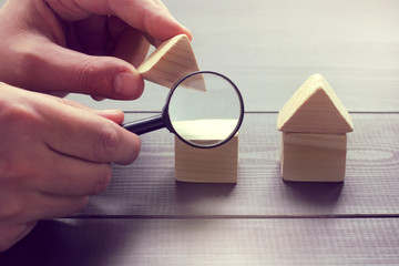 inspection of construction objects/ viewing in a magnifying glass the design of a house layout