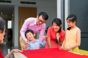 Cheerful family learning calligraphy