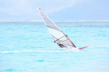 Man windsurfing at sea resort