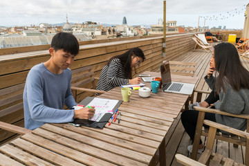 Chinese Entrepreneurs working from home balcony