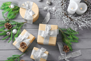 Gift boxes and Christmas decorations on wooden table