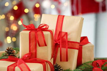 Gift boxes against blurred Christmas lights