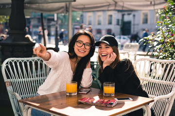 Beautiful friends in a cafe Madrid