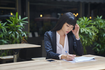 Portrait of young businesswoman stressed with work