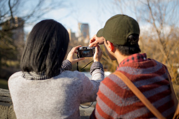 Asian tourist taking photos in central park