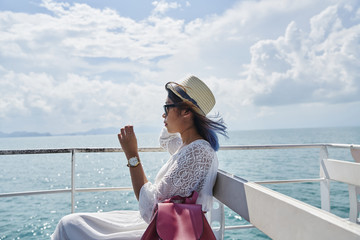 Side view of a young woman on the way to Koh Kood Island, Thailand