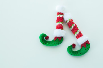 red and Green Christmas elf boots isolated on white