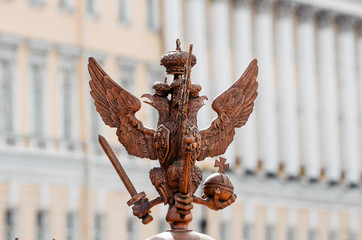 Two-headed eagles on the fence around the pillar of Alexandria, on Palace Square In St. Petersburg