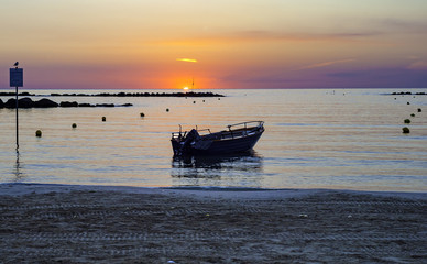 Peaceful and beautiful scene of local wooden boats with dawn sky and sun light