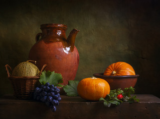 Still life with pumpkins and grapes