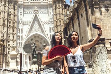Chinese women taking selfie
