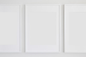 Set of 3 Blank Poster Frames in a Living Room