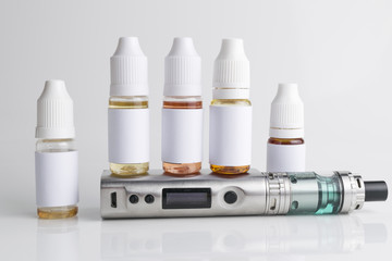 Isolated e liquid bottles and electronic cigarette, e cig for vape devices over a white background