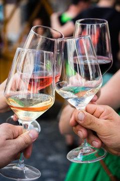 Hands holding wine glasses celebrating concept