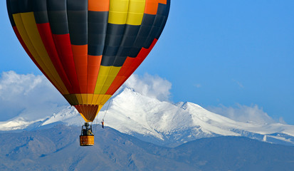 Acrylic Prints Balloon Hot air balloon with Colorado's Rocky Mountains in the background.