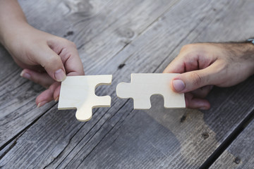 business people assembling jigsaw puzzle and represent team support and help concept. Building a business success. Concept for consulting, marketing, business, strategy and planning.