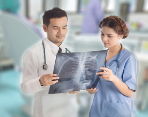 doctor working with x-ray film
