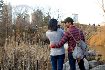 Asian tourist couple taking photos  in Central Park
