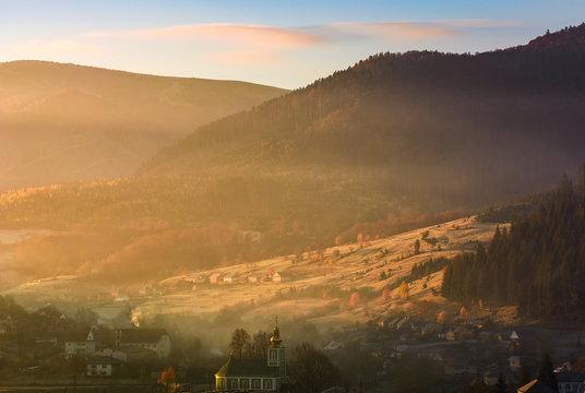 foggy sunrise in mountainous countryside
