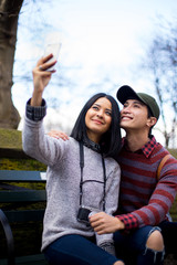 Lovely Asian couple taking a selfie in Central Park