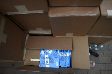 """Boxes of """"resist"""" signs are stacked near the entrance  during the 6th annual Made in America Music Festival"""