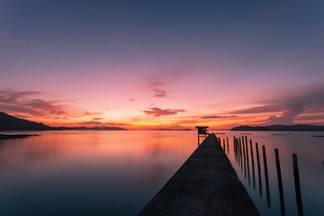 scenery view of old jetty to the sea beautiful sunrise or sunset in phuket thailand.