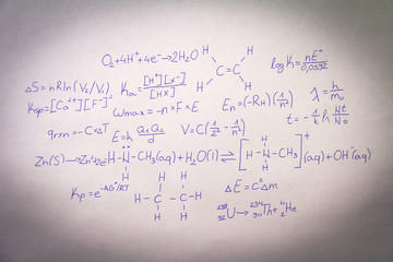 Formulas written on paper