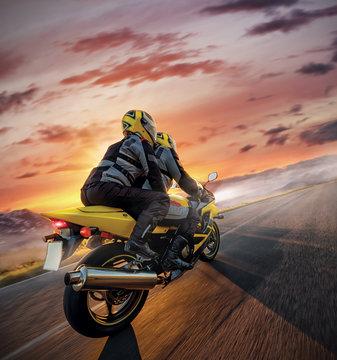 Motorbikers on sports motorbike riding in alpine landscape.