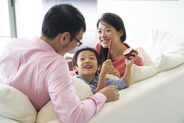 Family of three bonding in the living room