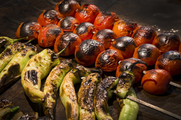 Tomato and pepper on the grill