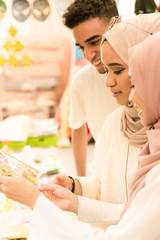Three muslim friends shopping